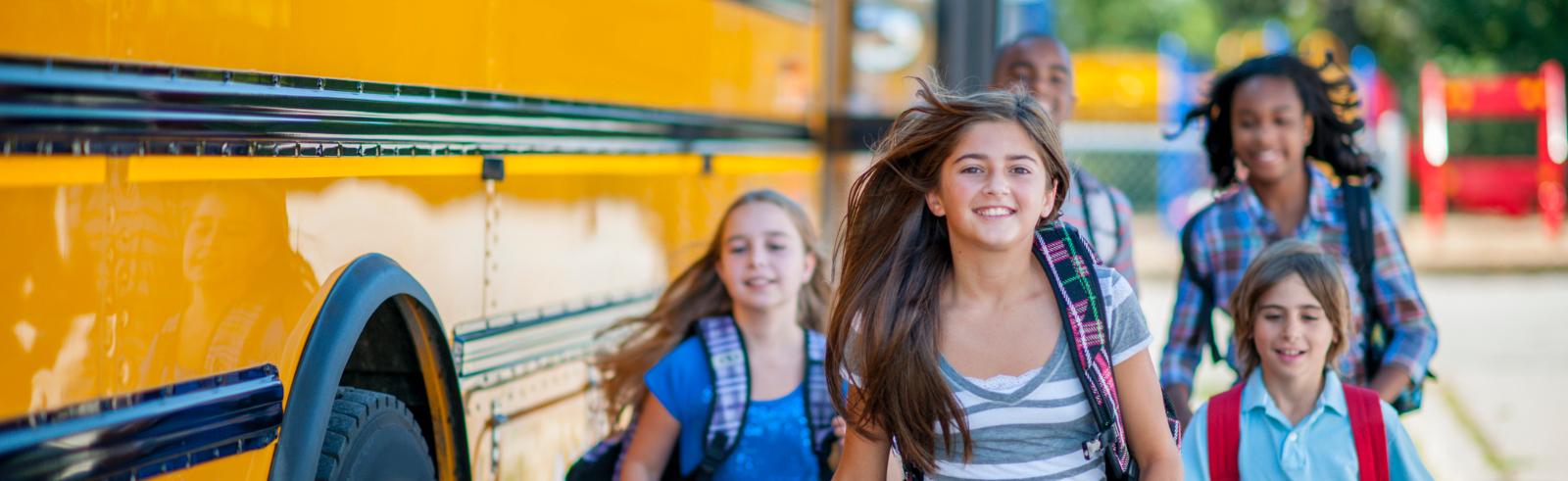 Students beside school bus